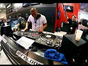 DJ Angelo performs at the Musikmesse show on the Reloop stand.