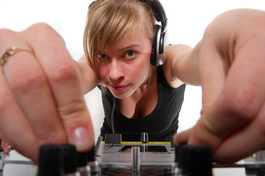 Teenage girl DJ adjusting sound levels