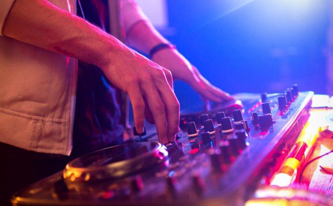 DJ plays a gig on a controller