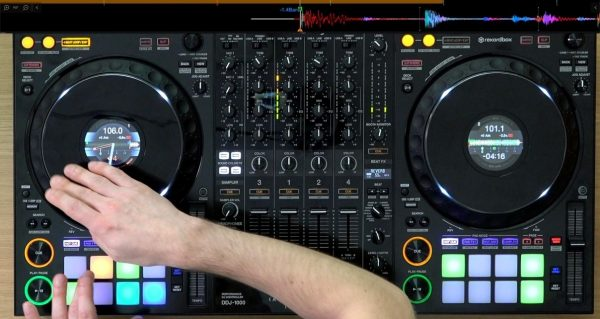 DJ performs techniques on a Pioneer DJ controller