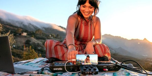 girl DJing with Roland interface mountainside