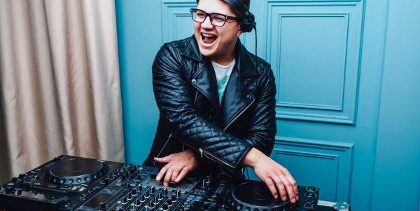 Cool DJ behind DJ booth